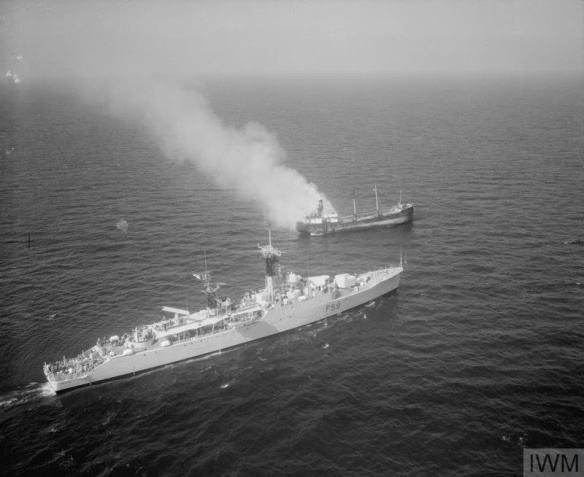 NAVY SAVES CREW FORM BURNING COASTER. SEPTEMBER 1958, VIEW FROM A HELICOPTER. THE FRIGATE HMS CHICHESTER PICKED UP THE CREW OF THE SMALL COSTA RICAN COASTER CONCHA, WHICH BURST INTO FLAMES AFTER AN EXPLOSION OFF THE PEMBROKESHIRE COAST.